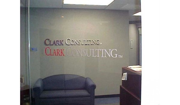 Custom Logo in dimensional carved letters for interior wall and window graphics